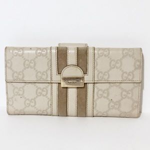 Gucci embossed monogram leather strip long wallet